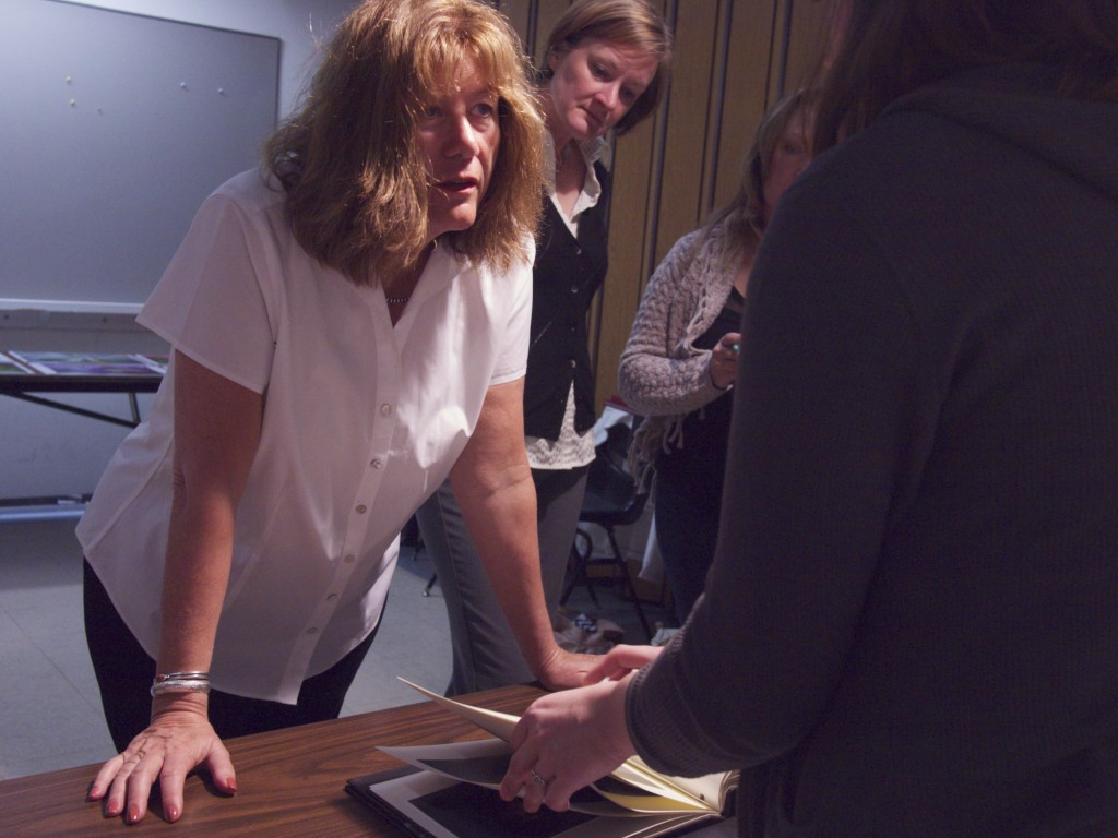 Mary Virginia Swanson working with students at College of DuPage